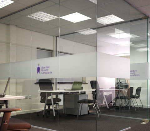 Glass partitions with manifestation graphics at Guardian Pensions's offices