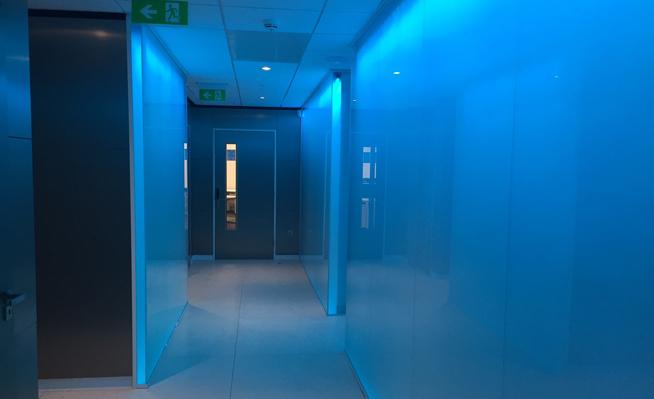 EKM back-lit, glass-walled corridor