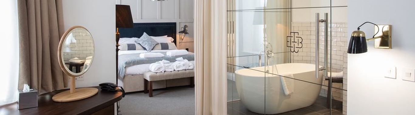 En-suite bathroom with glass walls