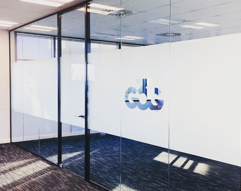 Office glass partition with a black frame