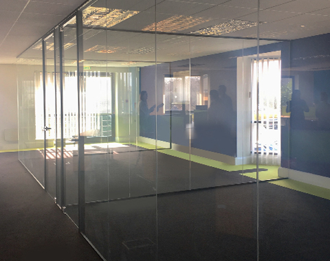 Workplace with glass partition walls