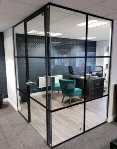 Black framed glass partition and door