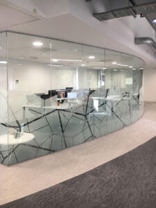 Glass partition with manifestation